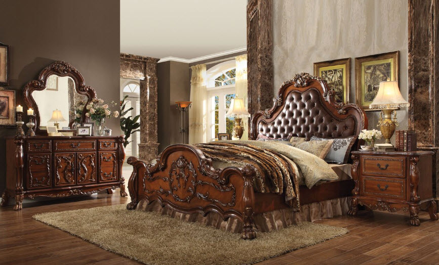 Traditional In Style The Whittington 7 Pc Cherry Wood Queen Bedroom Set Features A Sleigh Upholstered Bed Nine Drawer Dresser Mirror And